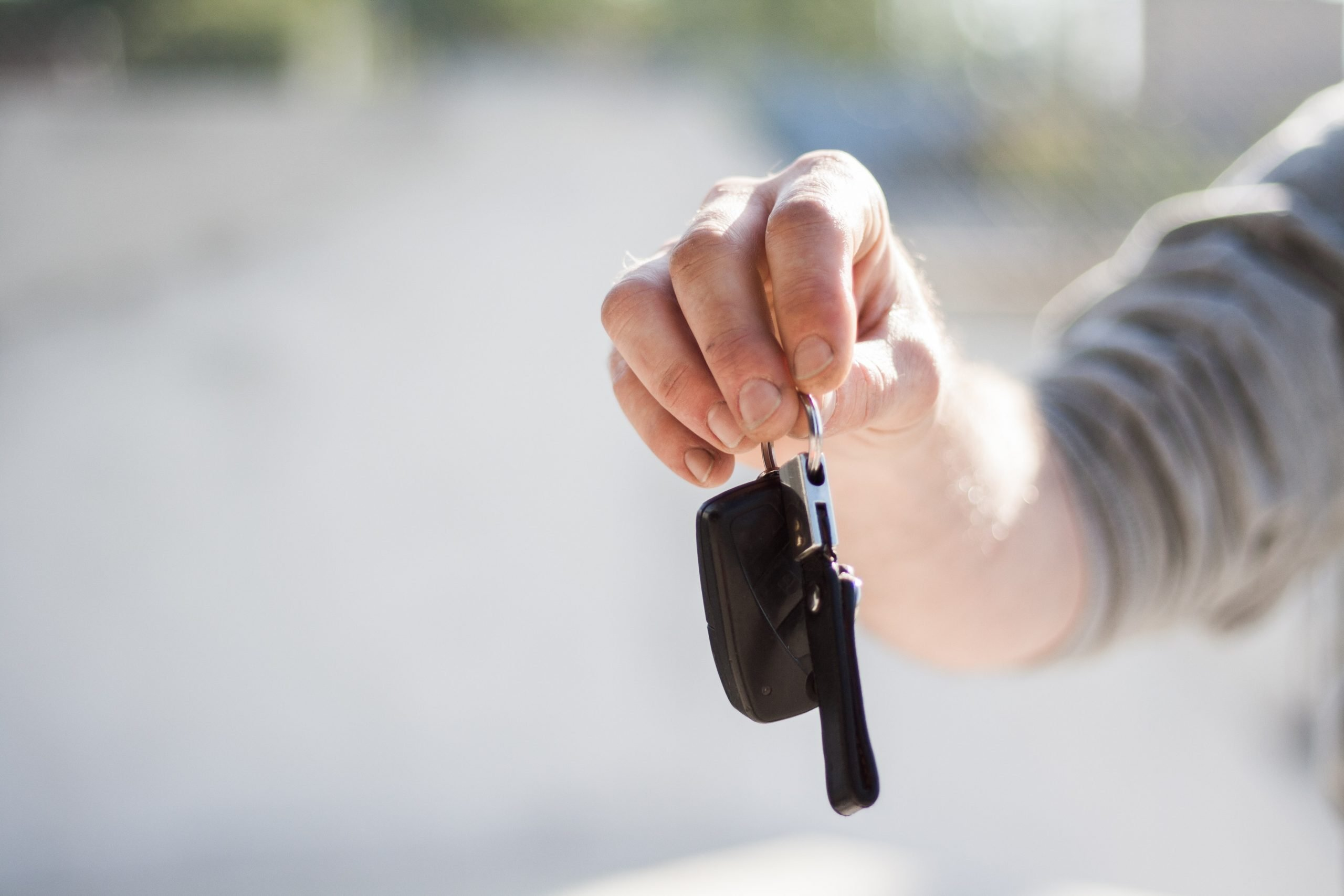 person giving car keys to someone else